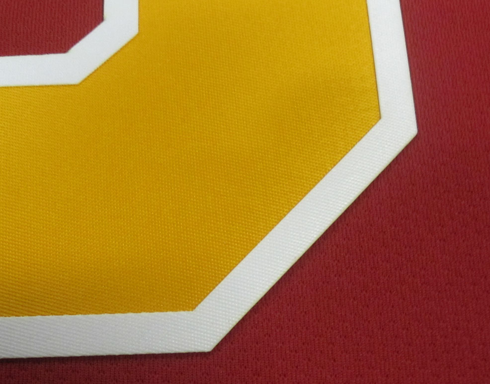as traditional tackle twill numbers except that the adhesive backing is permanant once heat applied and does not require sewing perma twill numbers are