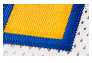 traditional tackle twill view a polyester fabric number traditonal to most hockey jerseys that is heat applied and then stiched to the jersey